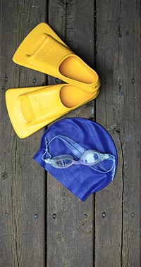 swimming goggles, cap, and fins